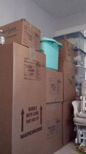 Full boxes stacked neatly in a corner--about as clutter-free as a move can get!